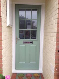 Elegant, Chartwell Green 2 Panel 1 Grill Glazed Composite Door with Chrome Furniture.