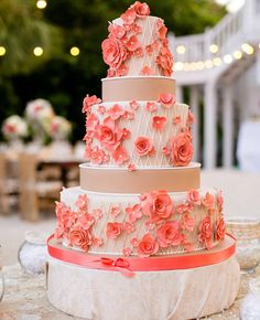 Coral Sugar Flower Cake | https://www.theknot.com/content/top-most-amazing-wedding-cakes-of-2013