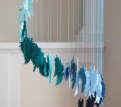 DIY ombre feather chandelier home decor by Creativebug. Make It Now in Cricut Design Space with the Cricut Explore machine.