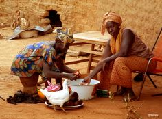 Mali, two women preparing food