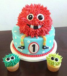 Red Monster Cake! - Red Monster Cake with matching monster cupcakes.  Monster eyes are black gum balls.  Cake is marshmallow fondant and monster hair is buttercream.