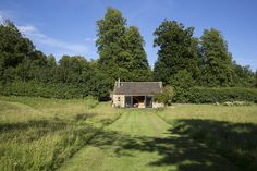 The stone barn is located in a meadow in Gloucestershire and is part of a larger property (grander main house included).