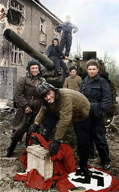 Lieutenant Tovolzhansky wipes his boots with Nazi flag at ACS Deerslayer on the street of Breslau, 1945 Apr of Russia, World War 2 History Online, World History, World War Ii, Red Army, History Photos, Panzer, Military History, Historical Photos, American History