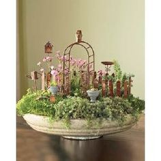 yes- fairy garden in the old birdbath!!!