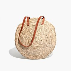 """Based in Montreal, Indigo&Lavender works with artisans from all over the Mediterranean. This round shoulder bag is handwoven in Marrakech of sustainable palm leaves. The vibe? Very Paris in the '70s. <ul><li>Palm leaves, leather.</li><li>31"""" shoulder strap.</li><li>19"""" opening.</li><li>Import.</li></ul>"""