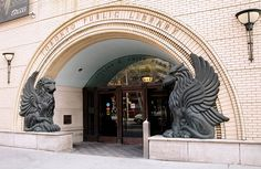 Lillian H  Smith Branch entrance Toronto Public Library. Bronze griffins flank entry.