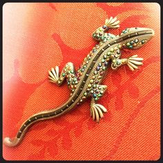 Betsey loves lizards!!!  Vintage Betsey lizard pin. Pewter colored lizard with a strip of black beading winding down the twisting back. The gems and crystals are what shines though. Match with anything!!!!! Mint ⛱ Betsey Johnson Jewelry
