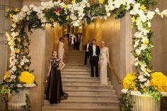 Models in 20s-style dresses and white-tie tuxedos lined the staircase at the entrance. The dresses were loaned by Holt Renfrew, and LOréal Paris provided era-appropriate makeup and hairstyles.