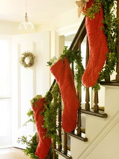No fireplace? Hang stockings and garland from the stair railing. More Christmas garland ideas: http://www.bhg.com/christmas/garlands/holiday-garland-ideas/?socsrc=bhgpin112512railingstockings#page=16