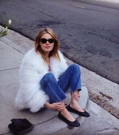 white faux fur jacket, denim skinny jeans, and black flats