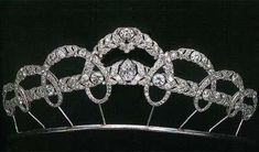 DIAMOND GARLAND TIARA MADE BY CARTIER      In 1927 Queen Victoria Eugenia of Spain ordered a tiara with arching laurel wreaths interwined around two horizontal garlands of leaves, a thematic invention which, considering the predominant styly of art deco at this time, can be explained only by reference to the requirements of traditional court etiquete