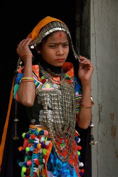Nepal | Portrait of a young Rana Tharu woman.  | © Philippe Guy