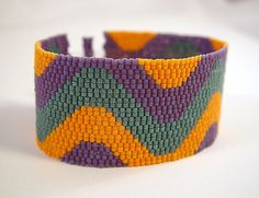 """Another cuff in the """"Squiggle"""" series. This one includes three colors from the Fall/Winter 2009-2010 color palette: light orange, matte lavender and deep sea teal."""