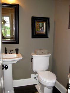 hall bath idea. Tan walls white trim bronze accents. Simple bathroom decor