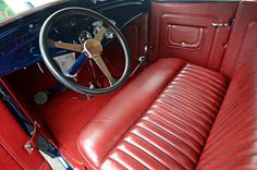 A 1933-1934 truck dashboard was cut and fit to the roadster. A Glide
