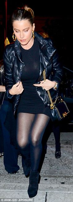 Dazzling: The 44-year-old Colombian beauty dazzled in a figure-hugging black number that skimmed her gym-honed thighs as she arrived at the celebrity hotspot