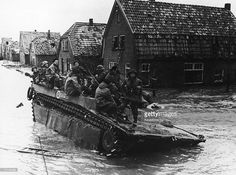 Canadian troops stranded on their amphibious vehicle east of Nijmegen by flooding wait to be rescued during World War II, 1945. The flooding was caused by bombing of the dykes. Pin by Paolo Marzioli