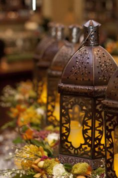 Lanterns and fall floral wreaths.