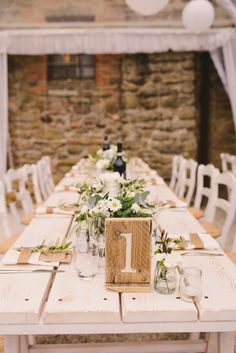 Trestle Table with Wooden Table Number - Firinn Photography   Outdoor Italian Destination Wedding at Casa Bruciata   Naomi Neoh Bridal Gown   Rachel Simpson Shoes   Mint Dessy Bridesmaids Dresses   Rustic Decor