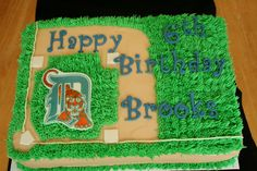 Detroit Tigers baseball cake with baseball field.