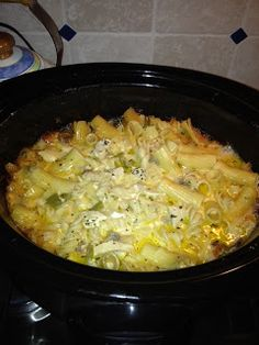 Crowd Pleaser Chicken in the Crockpot: 8 ounces noodles (a thicker noodle) 3 cups cooked chicken, diced 4 ounces canned mushrooms 1/2 cup chicken broth 1/2 cup Parmesan cheese 2 tablespoons butter, melted 1 cup sharp cheddar cheese 1/2 teaspoon basil 1 1/2 cups small curd cottage cheese 1 can cream of chicken soup