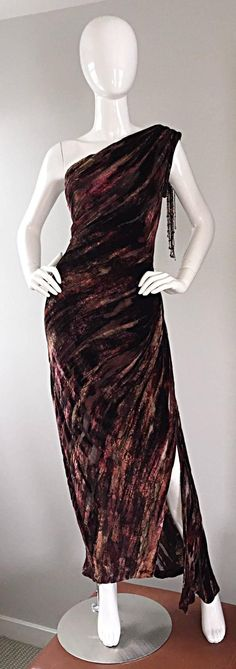 one shoulder burnt-out silk velvet gown! Couture quality, with a heavy amount of attention paid to detail. Autumnal colors of burgundy, wine, and tans. Hand-sen beads at arm hole, and multiples that dangle from the back arm. Intricate draping at bust, with an asymmetrical hem, that reveals just the right amount of leg. Semi-sheer silk cut-outs throughout, with an attached silk slip that hits above the knees.