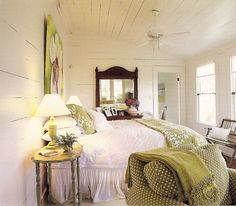 """Fresh green & white cottage bedroom with rustic white planked walls. From """"The Southern Cottage"""" by Susan Sully"""