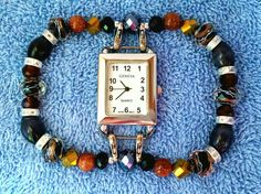 Rectangular white watch face with black, rust, gold, and clear crystal rondelles