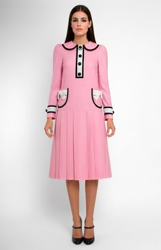 Low-waist long-sleeve genuine wool dress. Tucked turndown collar. Patch pockets and idle button placket decorated with velvet ribbon. Hidden back zip closure.