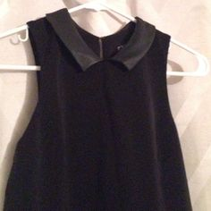 Black Dress with Faux Leather Perfect dress!!! Tight black dress with faux leather collar. Zippers on the side, has clasp on back for easy on/off. Express Dresses