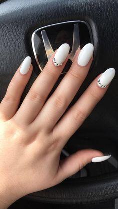 Perfect matte white almond acrylic nails with diamond stones / Pinterest @ShelbyHarms✨ #almondnails #whitenailpolish #nails