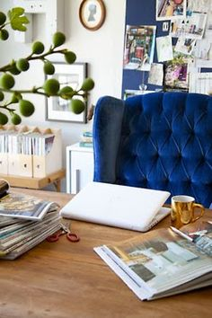big comfy blue chair, large wooden table, enormous pin board on the wall #PRworkspace