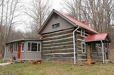 One of Brown County's original log cabins built in 1845. Hand-hewn logs. Lovingly restored during the past 3 years. Farm-style kitchen sink remains, reclaimed corrugated metal ceiling  commercial tile floor. Beautiful family room has been added with bright windows, slate floor  freestanding gas frpl. Large 24×13 bedroom upstairs. Master on the main. Full bath has clawfoot tub. Wonderful brick patio, pergola and hot tub. Cute det. guest studio. Barn, lake, garden spot, woods, creek.