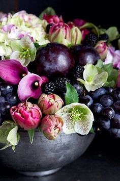 Would make a lovely wedding bouquet - Calla lilies, hellebore, hydrangea mixed with grapes and black berries by Michael George Flowers