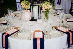 I like the idea of the navy napkins hanging off the table with a tiffany blue ribbon instead of the peach with the menu on top