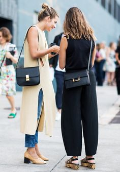 Left, a knit neutral dress is worn over cropped jeans, paired with neutral Céline heels and a Céline bag. Right, a black top is worn with black loose trousers, flat sandals, and a flap bag