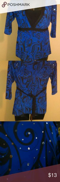 Beautiful Lane Bryant tie back blouse with sparkle Size 14/16 Navy blue with black swirl pattern. Mock black layered undershirt. Ties in the back. Silver Sparkles throughout the blue area. Blue is more of a navy than the royal blue it appears in the picture. Easy care 92% Polyester 8% spandex. No wrinkles! EUC Lane Bryant Tops Blouses
