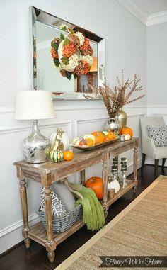 Mixed metals, pumpkins, cozy throw under table, fall hydrangea wreath.