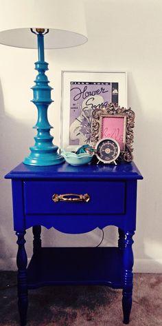 blue nightstand + teal-lamp + nightstand vignette