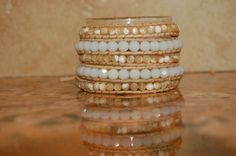 Mother of pearl and milky white beaded 5-row Wrap Bracelet. $125.00, via Etsy.