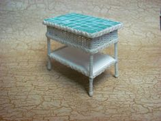 Dollhouse Miniature Furniture - How to make a 1 inch scale wicker table and faux tile top. Dollhouse Miniature Tutorials, Miniature Dollhouse Furniture, Miniature Crafts, Diy Dollhouse, Dollhouse Miniatures, Miniature Dolls, Barbie Furniture, Wicker Furniture, Wicker Dresser
