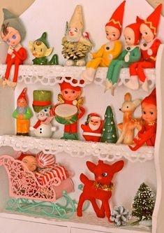 Kitsch Christmas display. See the elves? And wish I still had ours and use it for Elf on the shelf