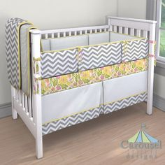 Crib bedding in White Minky Chenille, White and Gray Zig Zag, Eve's Garden, Solid Banana, Solid Antique White. Created using the Nursery Designer® by Carousel Designs where you mix and match from hundreds of fabrics to create your own unique baby bedding. #carouseldesigns