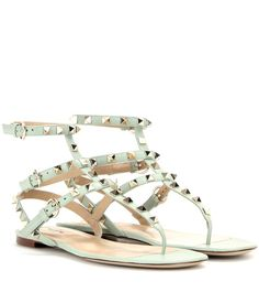 Valentino - Rockstud leather sandals - The coveted 'Rockstud' family welcomes a new addition. This flat sandal is crafted from butter-soft leather and comes in a pastel green hue. Finished off with iconic stud detailing adorning the strappy design, we're pairing ours with summer dresses and floaty trousers alike. seen @ www.mytheresa.com