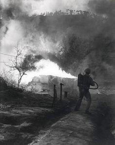 """""""Fiery Destroyer—As the First Marine Division advances in Korea, the flamethrower is used to deny communist infiltrators a hiding place."""" 5 May 1951"""