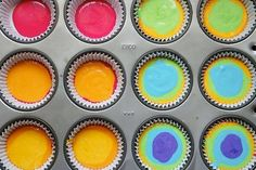 Rainbow cupcakes...drop a teaspoon of each color batter into baking cup...easy! by hannahmnt