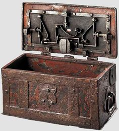 German painted iron casket  mid-16th c, This lockbox is reinforced with iron bands, has a hinged lid and a false lock on the front. The elaborate true locking mechanism has three spring-loaded latches on the inside of the lid   Dimensions 13 x 24 x 12.5 cm.
