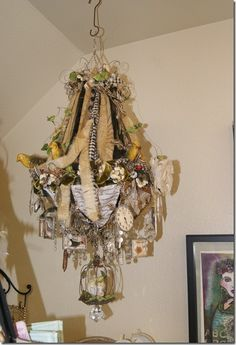 Diana Frey's studio chandelier - maybe a cheap light fixture with some ribbon and woodsy elements?