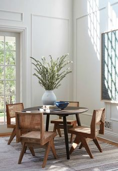 california casual dining room with rattan chairs contemporary dining room design, modern dining room design with white walls, modern dining room table, modern dining room chairs and modern chandelier, neutral dining room decor Dining Room Design, Interior Design Kitchen, Dining Room Table, Room Interior, Dining Chairs, Wood Chairs, Beach Dining Room, Study Chairs, Dining Corner