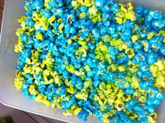 Colored Popcorn 2 cups sugar 1/2 cup water 1 tbsp butter 1 tsp food coloring 1/4 tsp salt Combine in a small saucepan and bring to a boil. Simmer stirring occasionally for 3 minutes. Pour over a huge bowl of plain popped corn and stir until evenly coated and dry.